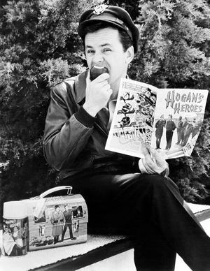 HOGAN'S HEROES, Bob Crane with thermos, lunchbox and comic book all product spinoffs from the show,